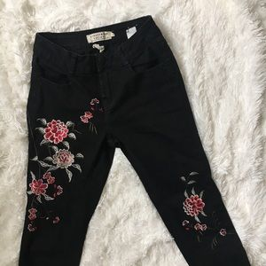 Black embroidered jeans